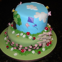 1St Birthday Garden Cake Butter cake, with vanilla buttercream filling and fondant icing. Decorations made of modelling paste or fondant. Inspired by several other...