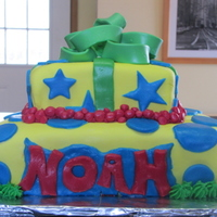 "First ""real"" Cake I made this for a baby shower. I have never taken a class but am proud of my first ""real"" cake. It is a lime cake with coconut..."