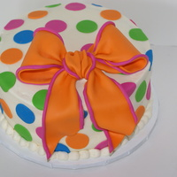 Sweet 16   Chocolate cake iced with vanilla buttercream. Decorated with fondant dots and bow.