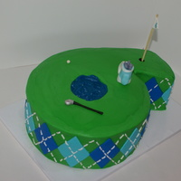 Golf Cake  Golf themed cake in the shape of a 6. Yellow cake with buttercream. Argyle print on the sides with fondant diamonds and white royal icing...