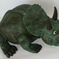 Triceratops   Chocolate cake covered with modeling chocolate with modeling chocolate features. Thanks for looking!