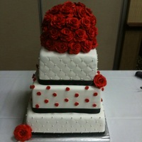 Red Rose Wedding Top two layers red velvet with cream cheese filling, bottome layer WASC with raspberry mouse filling. All coverd in fondant with red...