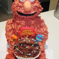Elmo Loves Chocolate Buttercream! My son's 2nd birthday cake. Elmo's body is out of cake and his head and arms and legs are rice krispie treats...