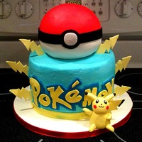 Pokemon I made the little yellow guy out of a mix of fondant & gumpaste.The top ball cake is covered in fondant, the bottom is buttercream with...