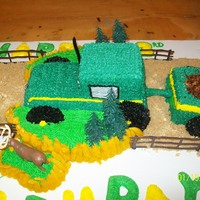 John Deere Tractor Cake This was my son's 3rd birthday cake, he wanted a tractor cake, so this is what I came up with. Everything is made of cake with...