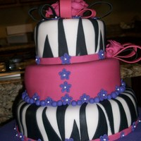 Zebra Zebra print cake. strawberry cake with strawberry cream filling. Red Velvet with Raspberry cream fillin.