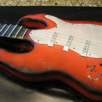 Rock 'n' Roll WASC cake covered in fondant. Neck of guitar is RCT. Very fun cake to make!