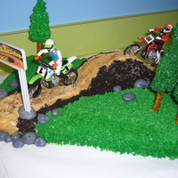 Motorcycles On A Dirt Track  I made this cake for my sons 3rd birthday. For the dark dirt I used crushed oreo cookies, and for the light colored dirt I used graham...