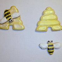 Bumblebees And Beehives Sugar cookies covered in color flow and painted with luster dust. Black accents on bee with fine point food color pen from Americolor.