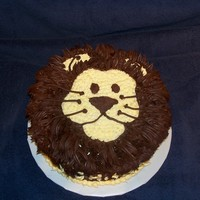 "Lionheart Cake Made for a dear uncle who is a ""Leo"" and collects lions. Milk chocolate cake and chocolate icing decorations."