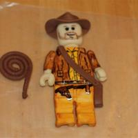 Lego Indiana Jones   Last minute order for a friend. I made the character and she put it on a cake. Modeling Chocolate and fondant.