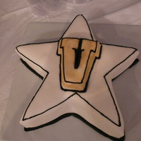 Vanderbilt Cake i carved this out of a square cake . MMF