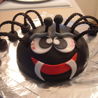 Spider Cake   I baked the cake in a metal bowl...all decorations are rolled fondant icing, except the legs are black licorice.
