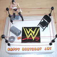 Wwe Birthday Cake  I made this cake for my grandson...who loves WWE....it was one layer chocolate, one layer red velvet with chocolate buttercream, and MMF......