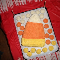 Candy Corn Cake   3 pound cake sheets carved and buttercream frosting