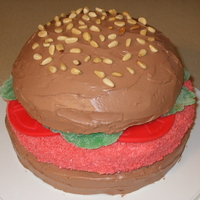 Crabby Patty  My great niece wanted a crabby patty cake. I made 2 cakes, one in a metal bowl for the bun top, and 2 round, 1 for the patty and 1 for the...