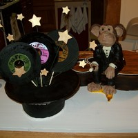 Magic Monkey Records Cake The monkey and hat are made of Rice crispy treats covered in modeling chocolate and the records and stars are of gumpaste.
