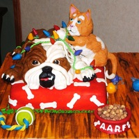 Bulldog And Kitten I made this cake for a fund raiser to benefit a local animal shelter. All the decorations are edible.