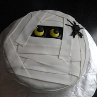 Boo!! This was soooo easy and fun to make!! It's a almond vanilla cake with orange butter cream filling and frosting. I used vanilla fondant...