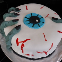 Eyeball  My very first cake using fondant...I really enjoyed making Halloween my first theme. I used Satin Ice Fondant, Chocolate fudge frosting...
