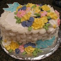 Basketweave Buttercream And Royal Icing Flowers This was my graduation cake from the Wilton Course II cake class. The royal icing flowers were made over the course of the class, along...