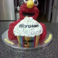 Elmo Elmo's head is RKT. His body is cake. Cupcake is chocolate cake with buttercream icing and fondant