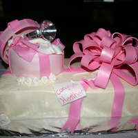 Gifts For The Bride  This was a sheet cake with 6 in round cake on top. 6 in covered in fondant and sheet cake covered with buttercream and embossed with a...