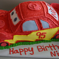 Lighting Mcqueen   This cake was carved out of sveral layers of cakecovered in buttercream and decorated with fondant accents.