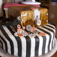 (Steampunk) Breaking In The crowbar, lock, and gears are all made out of fondant. The wooden box is hand painted, the black and white cake striped in fondant. Of...
