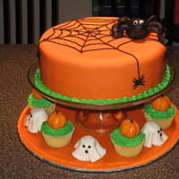 Halloween Cake halloween cake covered with fondant, spider, ghost and pumpkin all in fondant. Spiderweb in buttercream.