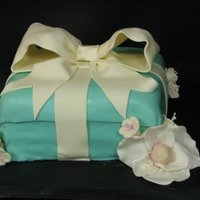 Tiffany's Bridal Shower Cake First tiffany's box cake. I made some rookie mistakes on allowing the frosting/filling to settle before covering in fondant so there...