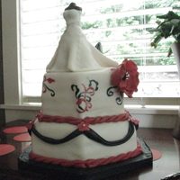 Black, White, Red Bridal Shower 10in, 8in hex cakes. Fondant covered with fondant details and hand painted scroll work to match the invitations. Dress is RKT covered in...