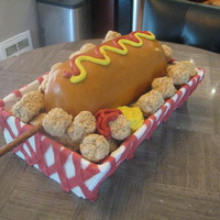 National Corndog Day Cake Cake for National corndog day! Rice krispie treat tater tots, cake covered in fondant. Thanks for looking!