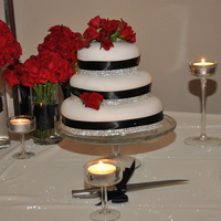 Made For Nieces Wedding the wedding was black and white theme used white fondant black ribbon and fresh sweet heart roses