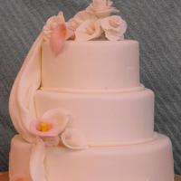 3 Tier Round Wedding Cake gumpaste flowers and draping