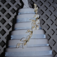 Arum Lilly Wedding Cake This was a huge cake and was quite a task stacking them. It is a very simple cake and the flowers are made from sugar florist paste. I only...