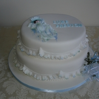 Baby Boy Christening/baby Shower Cake This two tiered cake makes a great cake for a Christening or Baby Shower. The baby and the lettering are made from gum paste. The garrett...