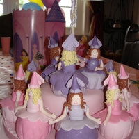 "Dancing Princess Cake I just loved making this cake. It was so fun! Each princess is a cupcake. Three princesses are on the top of a 6"" cake and are dancing..."