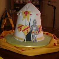 Knight Cake This was my son's 5th birthday cake. The cake was a madeira sponge cake with fondant icing. I painted the knight with edible silver...