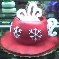 Mug Of Hot Chocolate With Snowflakes A double layer cake with whipped icing and real marshmallows. The handles and steam are made from piped confectionary coating.