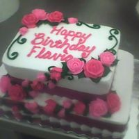 Stacked Sheet Cake With Cascading Pink Roses A double layer 1/8 sheet stacked on a single layer 1/4 sheet, iced in buttercream, with fabric ribbon. For a 16th birthday.