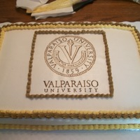 Grad She was going to that college so I made a waffer paper and drew the valpo logo.