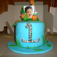 Small Jungle Cake Dominican cake with dulce de leche filling. All decorations, fondant. This cake was lots of fun, even though the number one took about an...