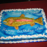 Fish Cake   fondant fish, fly, butter cream frosting. Buck doe trout is a family joke...