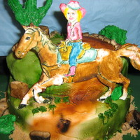 Hanna's Cowboy   Horse is painted gum paste, cake is butter cream. White chocolate cactus.