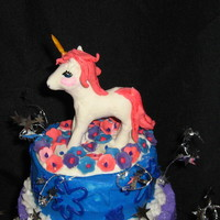 Unicorn Cake   Butter cream with a white chocolate unicorn.
