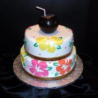 50Th Birthday Hawaiian Luau Cake A 2 tier Hawaiian Luau type cake that I did for my friends mother who turned 50. I made the coconut with a Styrofoam ball and the Hibiscus...