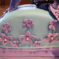 Flower Purse Cake   Double chocolate cake with white chocolate fondant & gumpaste flowers.All for a very special 7 yr old :)