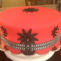 Simple Birthday Cake Carrot cake with cream cheese filling/frosting and covered in red Satin Ice Fondant.Decorated quickly, prior to heading out to beach to...
