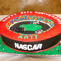 Nascar Theme Cake First carved cake. Needs improvement, but not bad for my first.